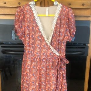 (NWOT) Printed lined wrap dress with lace trim.